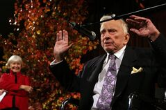 Joanne Woodward, left, stands by as Gore Vidal speaks at the National Book Awards in New York. Woodward presented Vidal with the Medal for Distinguished Contribution to American Letters. Vidal died Tuesday, July 31, 2012, at his home in Los Angeles. He was 86. (AP Photo/Tina Fineberg, File)