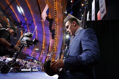 Johnny Manziel, from Texas A&M, walks onstage after being selected 22nd overall by the Cleveland Browns during the first round of the NFL football draft, Thursday, May 8, 2014, at Radio City Music Hall in New York. (AP Photo/Jason DeCrow)