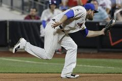New York Mets first baseman Lucas Duda (21) snags a line drive hit by Atlanta Braves' Tommy La Stella for an out in the ninth inning of a baseball game, Thursday, July 10, 2014, in New York. The Braves won 3-1. (AP Photo/Julie Jacobson)