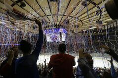 Streamers drop from the ceiling as hockey fans celebrate the Rangers 1-0 win over the Montreal Canadiens in Game 6 of the NHL hockey Stanley Cup playoffs Eastern Conference finals, Thursday, May 29, 2014, in New York. (AP Photo/Frank Franklin II)