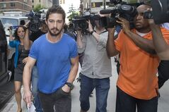 Actor Shia LaBeouf walks through the media, Friday, June 27, 2014, in New York, after leaving Midtown Community Court following his arrest the previous day for yelling obscenities at the Broadway show