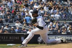 New York Yankees relief pitcher Dellin Betances throws in the sixth inning of a baseball game against the Los Angeles Angels at Yankee Stadium, Saturday, April 26, 2014, in New York. (AP Photo/John Minchillo)