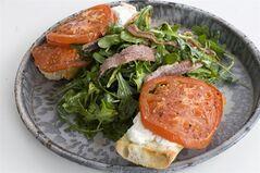 In this image taken on Feb. 11, 2013, an open-faced anchovy sandwich with balsamic arugula is shown served on a plate in Concord, N.H. (AP Photo/Matthew Mead)