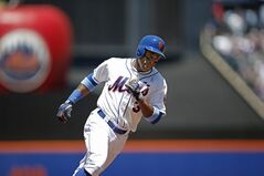 New York Mets' Curtis Granderson runs the bases after hitting a first-inning solo home run off San Diego Padres starting pitcher Ian Kennedy during a baseball game in New York, Sunday, June 15, 2014. (AP Photo/Kathy Willens)