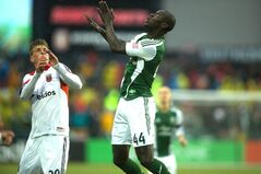 Pa-Modou Kah (right) of the Portland Timbers looks for the ball against DC United on Saturday. May 3, 2014 at Providence Park in Portland. (AP Photo/The Oregonian, Jamie Francis