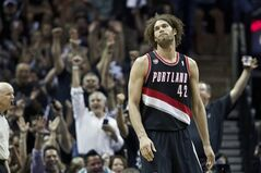 Portland Trail Blazers' Robin Lopez (42) looks on during Game 2 of a Western Conference semifinal NBA basketball playoff series against the San Antonio Spurs, Thursday, May 8, 2014, in San Antonio. San Antonio won 114-97. (AP Photo/The Oregonian, Bruce Ely)