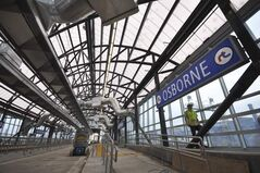 Osborne Street Station references the great train stations of Europe, while its arching trusses evoke Winnipeg's elm tree canopy.