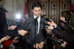 Liberal Leader Justin Trudeau speaks to reporters in the foyer of the House of Commons on Parliament Hill in Ottawa on Tuesday, February 25, 2014. THE CANADIAN PRESS/Sean Kilpatrick
