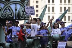 Members of the Taney Dragons baseball team are greeted by fans during a parade in Philadelphia, Wednesday Aug. 27, 2014, to celebrate the team's accomplishments during the Little League World Series. (AP Photo/ Joseph Kaczmarek)