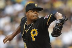 Pittsburgh Pirates starting pitcher Edinson Volquez throws against the Detroit Tigers in the first inning of the baseball game on Tuesday, Aug. 12, 2014, in Pittsburgh. (AP Photo/Keith Srakocic)