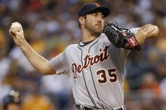 Detroit Tigers starting pitcher Justin Verlander throws against the Pittsburgh Pirates in the first inning of the baseball game on Monday, Aug. 11, 2014, in Pittsburgh. (AP Photo/Keith Srakocic)