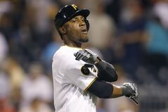 Pittsburgh Pirates' Starling Marte heads back to the dugout after flying out to St. Louis Cardinals center fielder Jon Jay for the final out of the Pirates' baseball game against the St. Louis Cardinals on Monday, Aug. 25, 2014, in Pittsburgh. The Cardinals won 3-2. (AP Photo/Keith Srakocic)