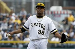 Pittsburgh Pirates starting pitcher Edinson Volquez (36) stands behind the pitchers mound after giving up a two-run home run to Toronto Blue Jays' Melky Cabrera in the fifth inning of the baseball game on Sunday, May 4, 2014, in Pittsburgh. The Blue Jays won 7-2. (AP Photo/Keith Srakocic)