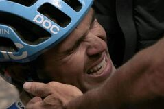 New Zealand's Jack Bauer, who rode in the two-man breakaway all of the race, cries after being caught by the sprinting pack in the last meters of the fifteenth stage of the Tour de France cycling race over 222 kilometers (137.9 miles) with start in Tallard and finish in Nimes, France, Sunday, July 20, 2014. (AP Photo/Peter Dejong)