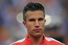 Netherlands' captain Robin van Persie listen to the national anthem of Ecuador prior to the international friendly soccer match between Netherlands and Ecuador at ArenA stadium in Amsterdam, Netherlands, Saturday, May 17, 2014. (AP Photo/Peter Dejong)