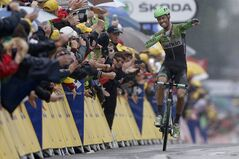 Netherland's Lars Boom celebrates as he crosses the finish line to win the fifth stage of the Tour de France cycling race over 155 kilometers (96.3 miles) with start in Ypres, Belgium, and finish in Arenberg, France, Wednesday, July 9, 2014. (AP Photo/Peter Dejong)
