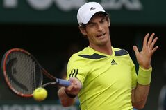 Britain's Andy Murray returns the ball during the quarterfinal match of the French Open tennis tournament against France's Gael Monfils at the Roland Garros stadium, in Paris, France, Wednesday, June 4, 2014. (AP Photo/Darko Vojinovic)