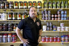 In this Thursday, July 24, 2014 photo, Frank Trumbetti, owner of Rock Bottom Nutrition, poses for a photo at his store in Cherry Hill, N.J. A new, large-scale national survey released Wednesday by the Partnership for Drug-Free Kids revealed that experimentation with human growth hormones by America's teens more than doubled in the past year. (AP Photo)