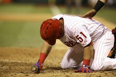 Philadelphia Phillies' Carlos Ruiz reacts after being hit by a pitch in the 11th inning of a baseball game against the Florida Marlins, Thursday, June 26, 2014, in Philadelphia. the Phillies won 5-3. (AP Photo/Laurence Kesterson)