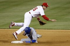 Toronto Blue Jays' Jose Bautista, bottom, collides with Philadelphia Phillies second baseman Chase Utley after being forced out at second on a double play by Edwin Encarnacion during the seventh inning of an interleague baseball game, Monday, May 5, 2014, in Philadelphia. Toronto won 3-0. (AP Photo/Matt Slocum)