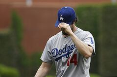 Los Angeles Dodgers starting pitcher Dan Haren adjusts his hat as he walks off the field after the second inning of a baseball game against the Philadelphia Phillies, Saturday, May 24, 2014, in Philadelphia. (AP Photo/Matt Slocum)