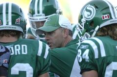 Saskatchewan Roughriders special teams coordinator Craig Dickenson talks to players during  a game against the BC Lions in 2011.