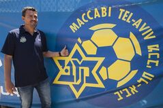 FILE - In this Thursday, May 31, 2012 file photo, former midfielder Barcelona player and Maccabi Tel Aviv Coach Oscar Garcia poses for photographers in Tel Aviv, Israel. Garcia has quit his job, with the club saying Tuesday it was because of the