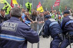 French rail workers clash against municipal police during a demonstration in front of the City Hall of Lille, northern France, Tuesday, June 17, 2014. A weeklong strike by French rail workers is heating up as the draft law goes to the lower house of Parliament for debate Tuesday. The bill would unite the SNCF train operator with the RFF railway network, which would pave the way to opening up railways to competition. Workers fear the reform will mean job losses and security concerns. The government says the reform is needed to create a stronger structure for the railways, as France and other European countries gear up for full-scale railway liberalization in coming years. (AP Photo/Michel Spingler)