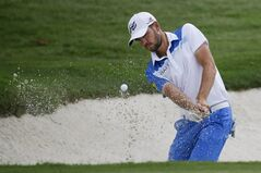 Troy Merritt hits out of the sand and onto the 16th green during the third round of the St. Jude Classic golf tournament Sunday, June 8, 2014, in Memphis, Tenn. Merritt made par on the hole. Weather delays during the week forced Saturday's third round to be finished Sunday morning before the final round could begin. (AP Photo/Mark Humphrey)