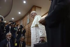 Pope Francis, center, arrives to attend a meeting with Asian bishops at the Haemi Martyrs Shrine in Haemi, south of Seoul Sunday, Aug. 17, 2014. Pope Francis outlined his priorities for the Catholic Church in Asia during a meeting of the region's bishops, urging them to listen to people of different cultures, show them empathy in dialogue while still remaining true to their own Catholic identity. (AP Photo/Ed Jones, Pool)