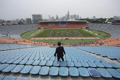 """In this Sunday, May 25, 2014 photo, volunteers form the words """"Tokyo 2020"""