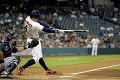 Houston Astros' George Springer (4) hits a home run as Atlanta Braves catcher Gerald Laird, left, reaches for the pitch during the first inning of a baseball game Tuesday, June 24, 2014, in Houston. (AP Photo/David J. Phillip)
