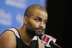 San Antonio Spurs guard Tony Parker listens to a question during a news conference for the NBA basketball finals on Saturday, June 14, 2014, in San Antonio. The Spurs play Game 5 against the Miami Heat on Sunday. (AP Photo/Tony Gutierrez)