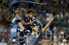 Stan Wawrinka, of Switzerland, reacts after defeating Tommy Robredo, of Spain, during the fourth round of the U.S. Open tennis tournament Monday, Sept. 1, 2014, in New York. (AP Photo/Jason DeCrow)