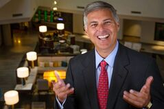 In this May 29, 2014 photo, Hilton CEO Chris Nassetta poses for a portrait in the Hilton Tysons Corner Hotel in McLean, Va. When Nassetta took over as CEO in 2007, Hilton lagged behind other hoteliers. Today, Hilton Worldwide is the largest hotelier in the world, by rooms, with 679,000 rooms. (AP Photo/J. David Ake)