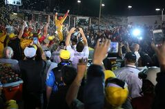 Joey Logano celebrates in Victory Lane after winning the NASCAR Sprint Cup auto race at Richmond International Raceway in Richmond, Va., Saturday April 26, 2014. (AP Photo/Richmond Times-Dispatch, James H. Wallace)