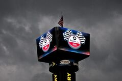 Dark clouds surround the scoreboard at Richmond International Raceway in Richmond, VA., Friday, April 25, 2014. qualifying for Saturday's Sprint cup race was cancelled. (AP Photo/Zach Gibson)