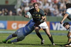 South Africa's Ruan Pienaar, center, is tackled by Argentina's Juan Manuel Leguizamon during their Rugby Championship match in Salta, Argentina, Saturday, Aug. 23, 2014. (AP Photo/Victor R. Caivano)