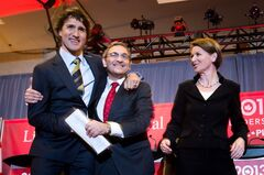 CORRECTED VERSION - CORRECTS BYLINE - Federal Liberal leadership candidates Justin Trudeau, left, and Martin Cauchon, centre, embrace as Martha Hall Findlay watches after the party's first leadership debate in Vancouver, B.C., on Sunday January 20, 2013. THE CANADIAN PRESS/Darryl Dyck