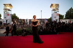 Actress Scarlett Johansson arrives on the red carpet for the screening of the film Under The Skin at the 70th edition of the Venice Film Festival held from Aug. 28 through Sept. 7, in Venice, Italy, Tuesday, Sept. 3, 2013. (AP Photo/Domenico Stinellis)