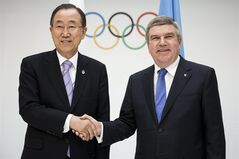 International Olympic Committee (IOC) president, Thomas Bach, right, shakes hands with United Nations (UN) Secretary General, Ban Ki-moon, left, at the IOC Headquarters in Lausanne Tuesday June 17 2014. The two leaders met to discuss the cooperation between the two organizations. (AP Photo/Keystone, Valentin Flauraud)