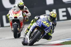Valentino Rossi of Italy, right, on his Yamaha competes against Andrea Iannone of Italy on his Ducati during the MotoGP Race of the Dutch Grand Prix, in Assen, northern Netherlands, Saturday June 28, 2014. (AP Photo/Vincent Jannink)