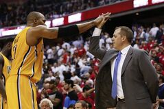 Indiana Pacers forward David West (21) high-fives Pacers coach Frank Vogel after Game 6 of an Eastern Conference semifinal NBA basketball playoff series against the Washington Wizards in Washington, Thursday, May 15, 2014. The Pacers defeated the Wizards 93-80 to advance to the Eastern Conference finals. (AP Photo/Alex Brandon)