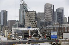 The scene of the SR 99 tunnel project along the Seattle waterfront is shown Monday, Feb. 10, 2014 in Seattle. The Washington state Transportation Department says the contracting team trying to dig the tunnel under downtown Seattle has advised that it will
