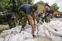 Soldiers from 17 Wing in Winnipeg sandbag in St. Francois Xavier. Several days of sandbagging is paying off a flood water is expected to pass through the region without breaching the dikes.