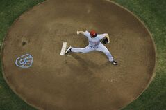 Cincinnati Reds starting pitcher Homer Bailey throws during the first inning of a baseball game against the Milwaukee Brewers Friday, June 13, 2014, in Milwaukee. (AP Photo/Morry Gash)