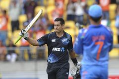 New Zealand's Ross Taylor, left, is applauded by India's MS Dhoni on reaching his century in the fifth and final one-day international cricket match in Wellington, New Zealand, Friday, Jan. 31, 2014. (AP Photo/SNPA, Ross Setford) NEW ZEALAND OUT