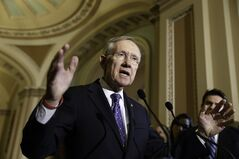 FILE - This June 3, 2014, file photo shows Senate Majority Leader Harry Reid of Nev., as he speaks to reporters on Capitol Hill in Washington. The Senate voted to advance an election-year bill limiting tax breaks for U.S. companies that move operations overseas. But big hurdles remain. (AP Photo/J. Scott Applewhite, File)