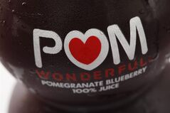 FILE - This Sept. 27, 2010 file photo shows a bottle of POM Wonderful juice in Philadelphia. The Supreme Court on Thursday sided with juice maker Pom Wonderful in its long-running false advertising dispute with Coca Cola, a decision that could open the door to more litigation against food makers for deceptive labeling. The justices ruled 8-0 that Pom can go forward with a lawsuit alleging the label on a