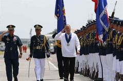 In this photo released by the Malacanang Photo Bureau, Philippine President Benigno Aquino III, third left, walks with Philippine Air Force Commanding General Lt. Gen. Jeffrey Delgado, left, during ceremonies on the 67th PAF Anniversary at the Clark Air Base, Pampanga province, northern Philippines, Tuesday, July 1, 2014. Aquino said Tuesday his country's ill-equipped military would get its first fighter jets in nearly a decade next year to help defend the country's territory. (AP Photo/Ryan Lim, Malacanang Photo Bureau)